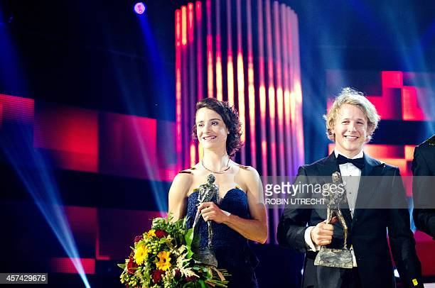 Dutch cyclist Marianne Vos amd gymnast Epke Zonderland pose with their awards for Dutch sportswoman and sportsman of the year at the 2013 Sports Gala...