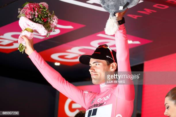 Dutch cyclist Tom Dumoulin of Sunweb celebrates on the podium with his pink jersey at the end of the 13th stage of the 100th Giro d'Italia Tour of...