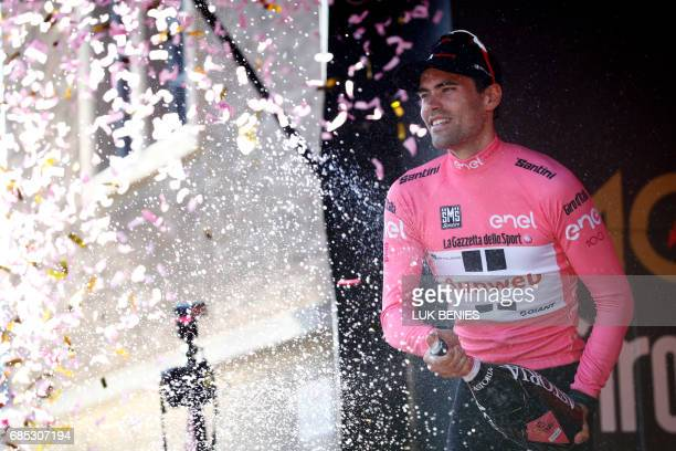 Dutch cyclist Tom Dumoulin of Sunweb sprays champagne as he celebrates on the podium with his pink jersey at the end of the 13th stage of the 100th...