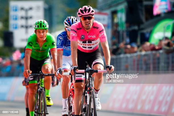 Dutch cyclist Tom Dumoulin of Team Sunweb wearing the overall leader pink jersey crosses the finish line at the end of the 19th stage of 100th Giro...