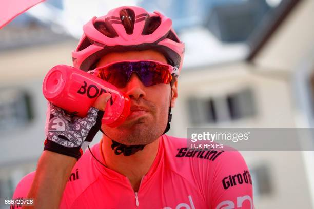 Dutch cyclist Tom Dumoulin of Team Sunweb wearing the overall leader pink jersey drinks prior to the start of the 19th stage of 100th Giro d'Italia...