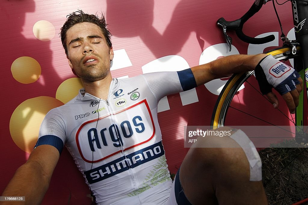 Dutch cyclist Tom Dumoulin (C) of the Argos-Shimano procycling team reacts at the end of the sixth stage of the Eneco Tour cycling race in Aywaille, on August 17, 2013. The event, formerly known as the Tour of Benelux, takes the peloton through Belgium and the Netherlands over seven stages and 1,080km.