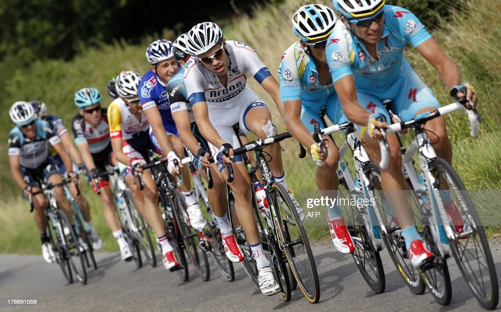 Dutch cyclist Tom Dumoulin (C) of the Argos-Shimano procycling team competes during the sixth stage of the Eneco Tour cycling race, from Riemst to La Redoute, in Aywaille, on August 17, 2013. The event, formerly known as the Tour of Benelux, takes the peloton through Belgium and the Netherlands over seven stages and 1,080km. AFP PHOTO/ANP/ BAS CZERWINSKI netherlands out