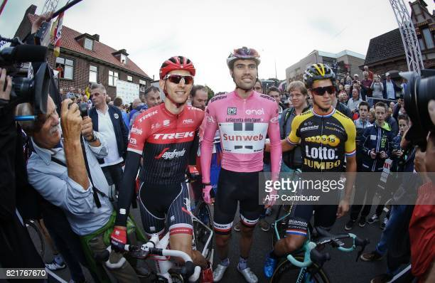 Dutch cyclists Bauke Mollema Tom Dumoulin and Dylan Groenwegen pose during 'Daags na de Tour' a traditional cycling event held yearly in Boxmeer on...