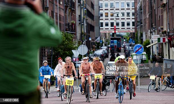 Dutch cyclists take part in the Naked Bike Ride in Amsterdam on June 9 2012 The event held in different parts of the world aim to raise public...