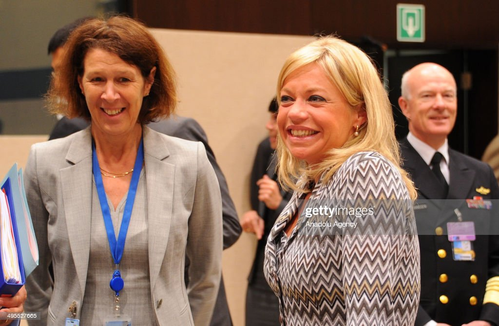 Dutch Defence Minister Jeanine Antoinette Hennis-Plasschaert (R) attends the second day of the NATO Defense Ministers meeting at NATO headquarters in Brussels, Belgium on June 4, 2014.