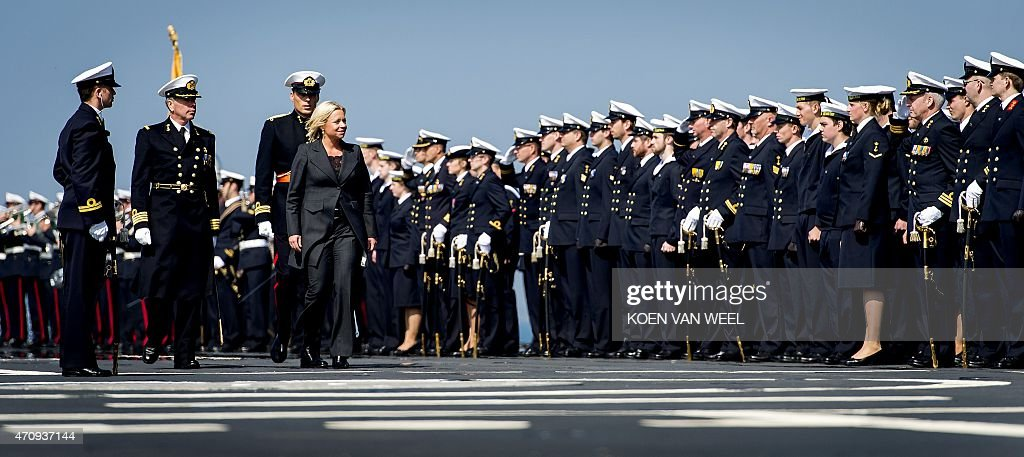 Dutch Defence Minister <a gi-track='captionPersonalityLinkClicked' href=/galleries/search?phrase=Jeanine+Hennis-Plasschaert&family=editorial&specificpeople=4314790 ng-click='$event.stopPropagation()'>Jeanine Hennis-Plasschaert</a> inspects the troops of the logistic support ship Karel Doorman in the port of Den Helder on April 24, 2015. The largest ship in the Dutch Navy will carry the royal predicate 'His Majesty' after the ceremony. **netherlands out**