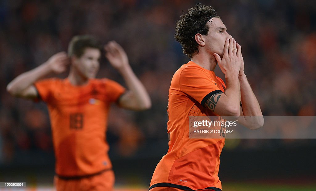 Dutch defender Daryl Janmaat reacts during the friendly football match Netherlands vs Germany on November 14, 2012 in Amsterdam. AFP PHOTO / PATRIK STOLLARZ