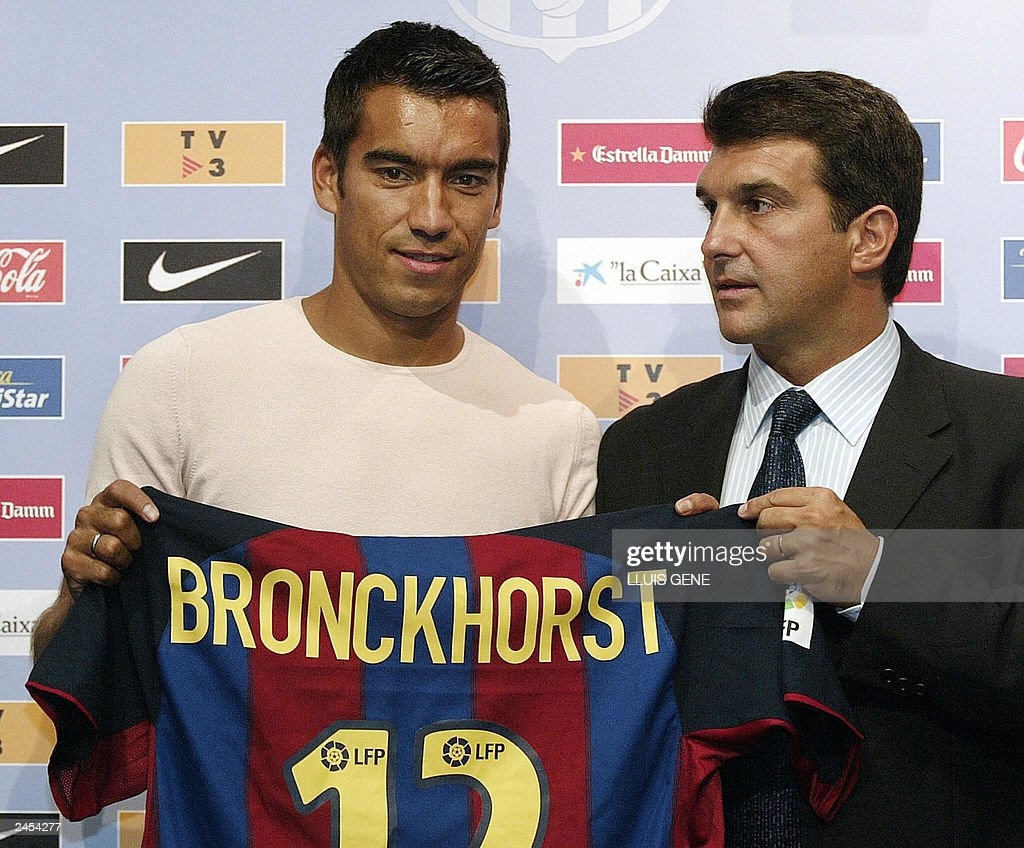 http://media.gettyimages.com/photos/dutch-defender-giovanni-van-bronckhorst-poses-with-fc-barcelonas-picture-id2454277