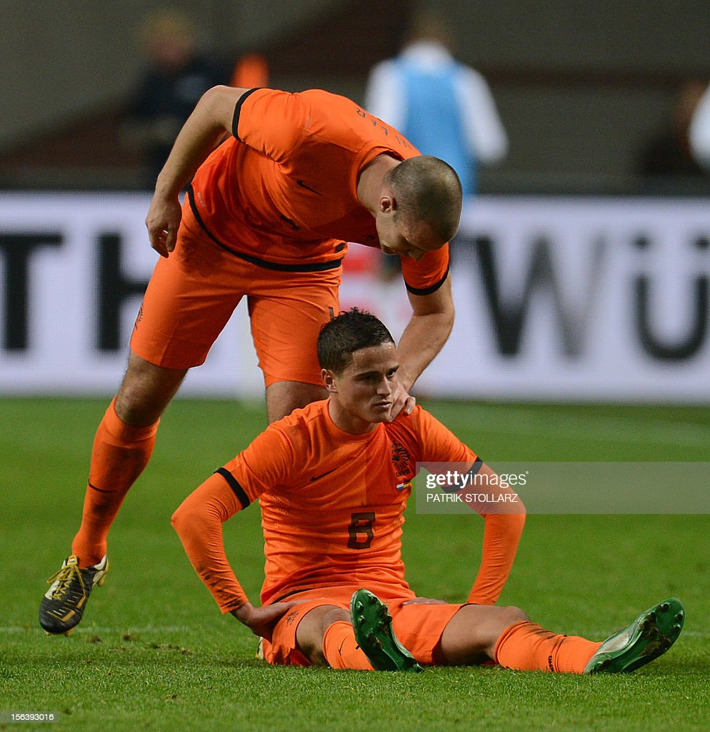 Dutch defender Ron Vlaar (L) comforts Dutch forward Ibrahim Afellay during the friendly football match Netherlands vs Germany on November 14, 2012 in Amsterdam.