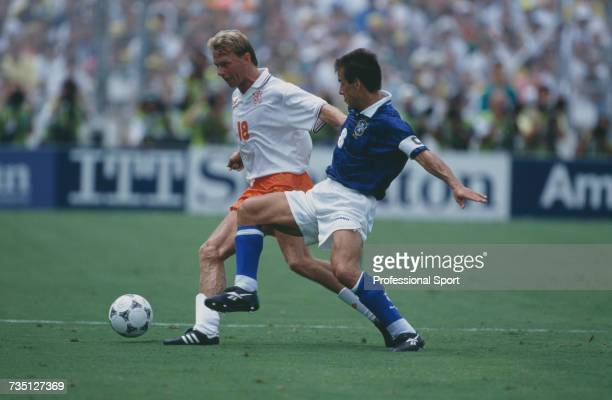 Dutch defender Stan Valckx closely marked by Brazil's captain midfielder Dunga attempts to keep possession of the ball during play in the 1994 FIFA...