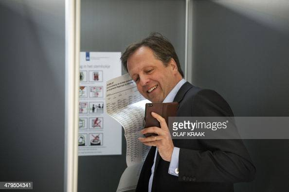 Dutch Democrats '66 party leader Alexander Pechtold makes a selfie when he casts his ballot in the Dutch municipal council elections at a polling...