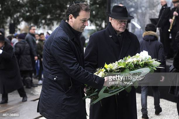 Dutch Deputy Prime Minister Lodewijk Asscher and state secretary Martin van Rijn place a wreath at the Auschwitz monument in the Wertheimpark in...