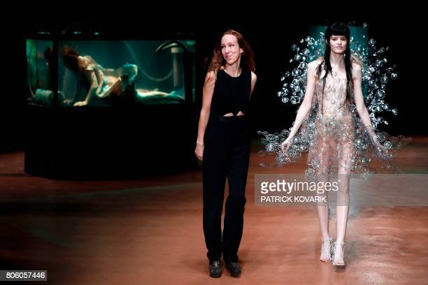 Dutch designer Iris Van Herpen acknowledges the audience at the end of the 2017 fall/winter Haute Couture collection in Paris on July 3 2017 / AFP...