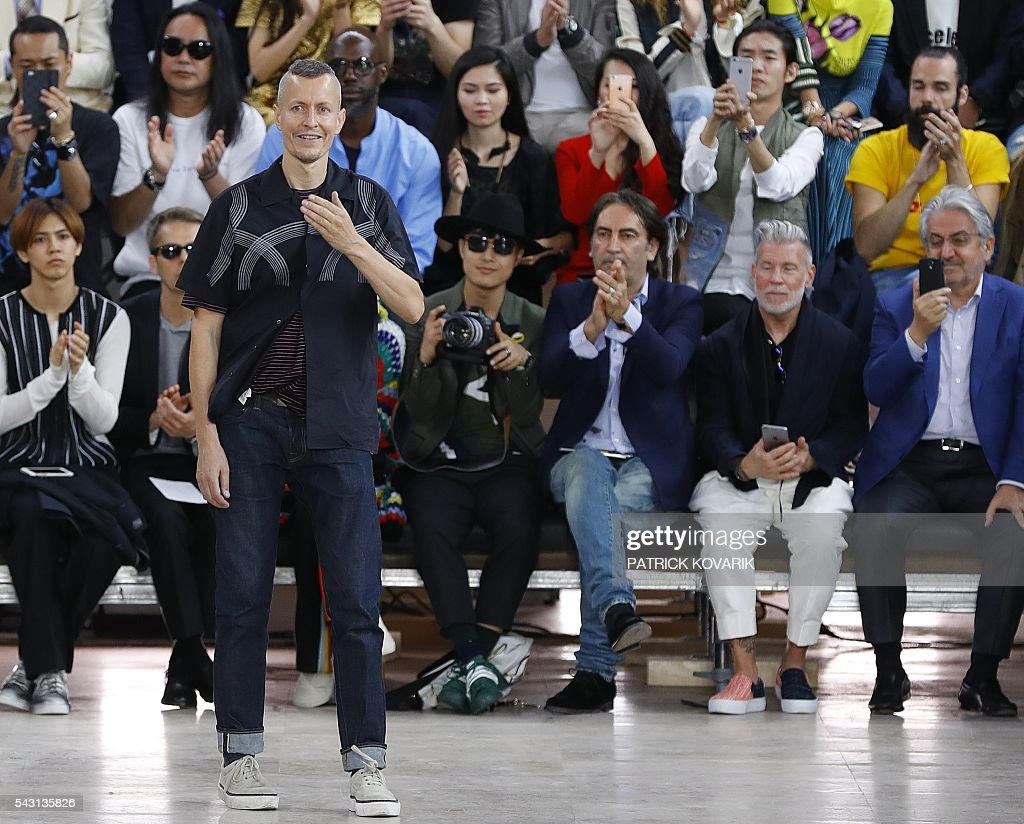 Dutch designer of Lanvin Lucas Ossendrijver acknowledges the public after his men's Spring/Summer 2017 collection fashion show on June 26, 2016 in Paris. / AFP / PATRICK