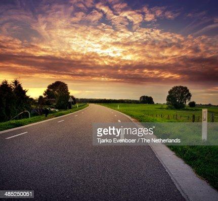 Dutch Dike road during sunset