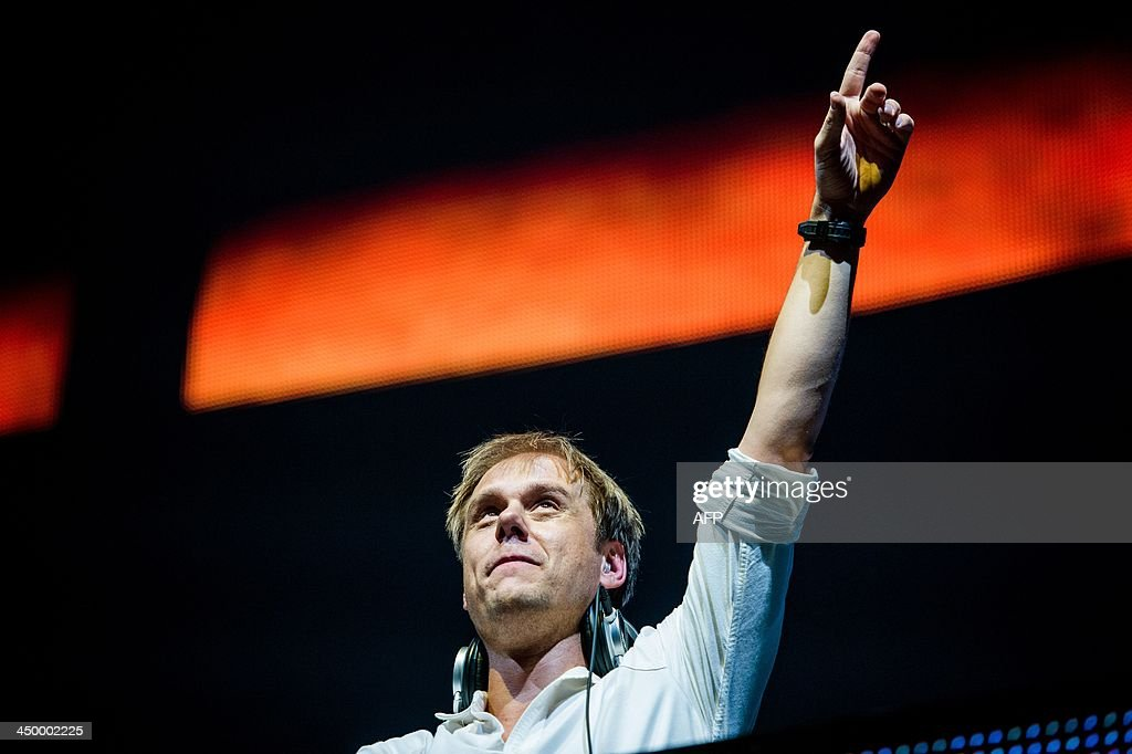 Dutch dj Armin van Buuren performs at the Ziggo Dome in Amsterdam early on November 16, 2013, at the start of his 'Armin Only - Intense' world tour. AFP PHOTO / ANP / FERDY DAMMAN