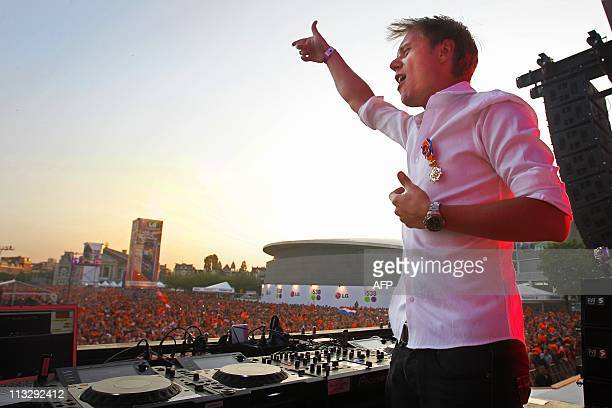 Dutch DJ Armin van Buuren performs during Queensday celebrations at the Amsterdam museum square on April 30 2011 AFP PHOTO / ANP / KIPPA ADE JOHNSON