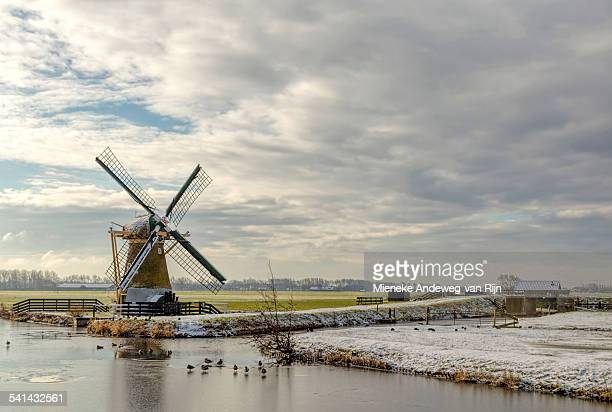 Dutch drainage mill in a wintry landscape