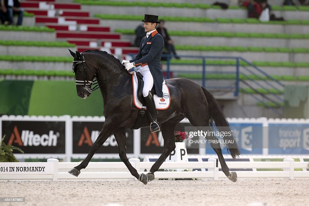 Dutch Edward Gal rides Glock's Voice on August 26, 2014 during the second session of the Dressage Grand Prix of the 2014 FEI World Equestrian Games at D'Ornano Stadium in the northwestern French city of Caen. TRIBALLEAU
