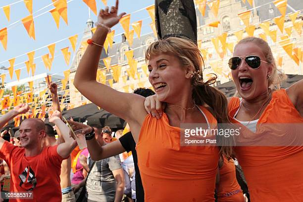 Dutch fans celebrate at an open air bar following the Holland defeat of Brazil in the World Cup in a 21 upset on July 2 2010 in Rotterdam Netherlands...