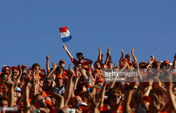 Dutch fans cheer on their team during the UEFA Euro 2004 Quarter Final match between Sweden and Holland at the Algarve Stadium on June 26 2004 in...