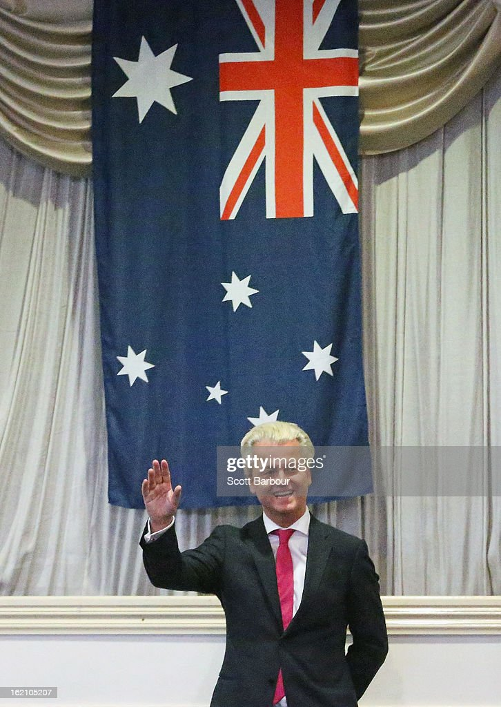 Dutch far-right politician and the founder and leader of the Party for Freedom Geert Wilders waves with the Australian flag behind him after speaking to members of the public on February 19, 2013 in Melbourne, Australia.