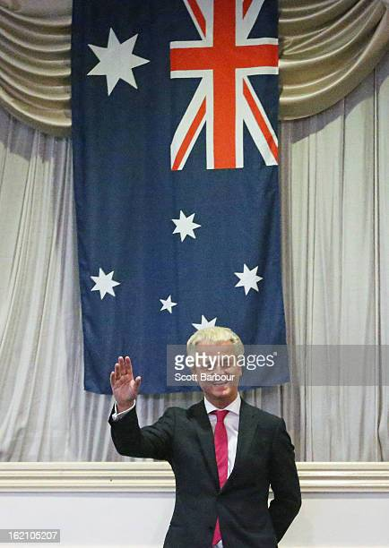 Dutch farright politician and the founder and leader of the Party for Freedom Geert Wilders waves with the Australian flag behind him after speaking...