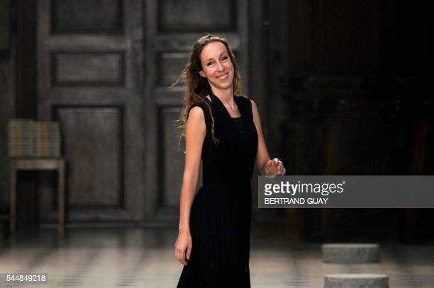 Dutch fashion designer Iris Van Herpen acknowledges the audience at the end of the 20162017 fall/winter Haute Couture collection fashion show on July...