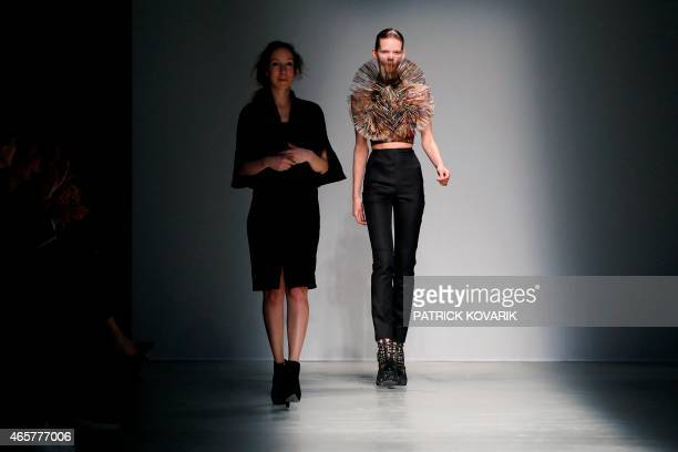 Dutch fashion designer Iris Van Herpen acknowledges the public at the end of the 20152016 fall/winter readytowear collection fashion show on March 10...
