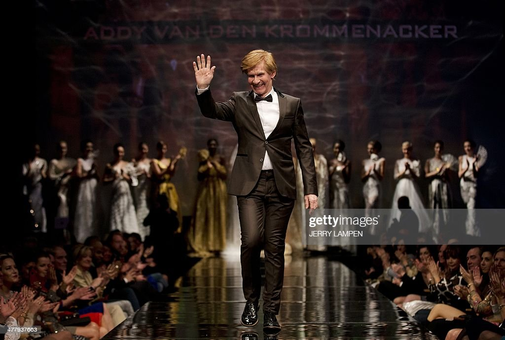 Dutch fashiondesigner Addy van den Krommenacker gestures as he stands with his models on the catwalk during the presentation of his Viago a Venezia...