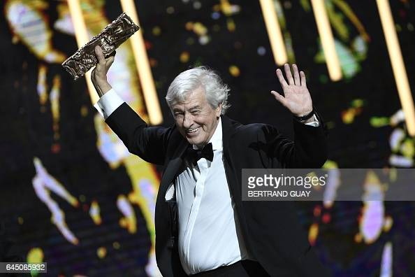 TOPSHOT Dutch film director Paul Verhoeven speaks on stage after receiving the Best Feature Film award for 'Elle' during the 42nd edition of the...