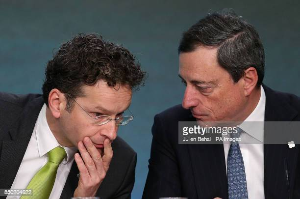 Dutch Finance Minister and Eurogroup chair Jeroen Dijsselbloem and European Central Bank President Mario Draghi at the Eurogroup press conference in...