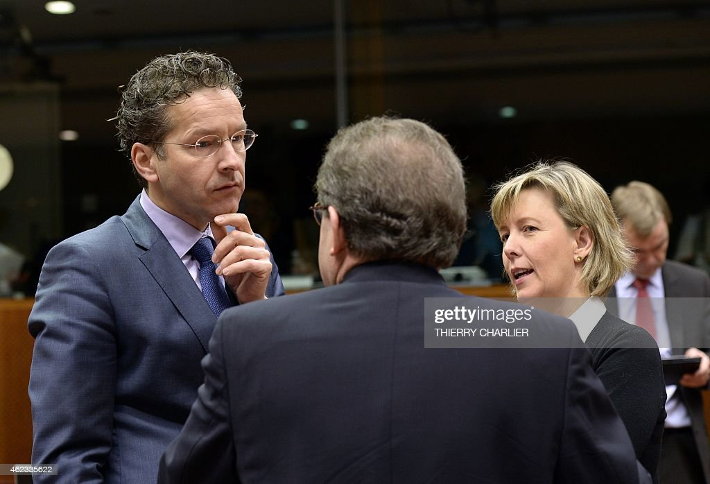 Dutch Finance Minister and President of the Eurogroup Jeroen Dijsselbloem (L) speaks with Portugal's Finance Minister Maria Luis Albuquerque (R) prior to the start of a meeting of the Economic and Financial Affairs Council (ECOFIN) at the European Union Council building in Brussels on January 27, 2015. AFP PHOTO / THIERRY CHARLIER
