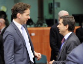 Dutch Finance Minister Jeroen Dijsselbloem and Eurozone president and Portuguese finance minister Vitor Gaspar talk prior to an Eurozone meeting on...