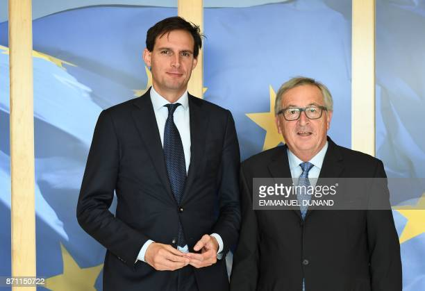 Dutch Finance Minister Wopke Hoekstra is welcomed by European Commission President JeanClaude Juncker at the European Commission in Brussels on...