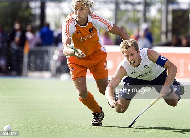 Dutch Floris Evers vies with Barry Middleton of England during the semi final of the EC Field Hockey in Amstelveen on August 28 2009 England won the...