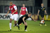 Dutch football cluyb AZ Alkmaar player Simon Poulsen in action with FC Anzhi Makhachkala player Oleksandr Aliyev during the UEFA Europa League...