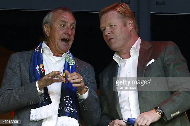 Dutch football legend Johan Cruijff and Feyenoord Rotterdam coach Ronald Koeman are pictured as they attend an UEFA Champions League group H football...