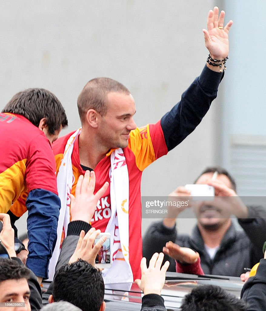 Dutch football player Wesley Sneijder is welcomed by Galatarasay supporters after his arrival at Ataturk airport on January 21, 2013. Dutch midfielder Wesley Sneijder said Monday he was 'very happy' to put his protracted departure from Inter Milan behind him as he left Serie A for Turkish giants Galatasaray on Monday.