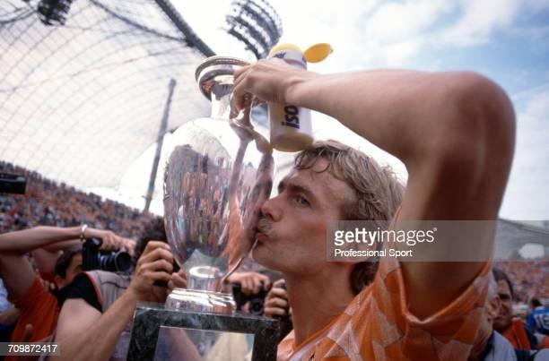 Dutch footballer Adri van Tiggelen kisses the UEFA European Championship trophy in celebration after Netherlands beat the Soviet Union 20 to become...