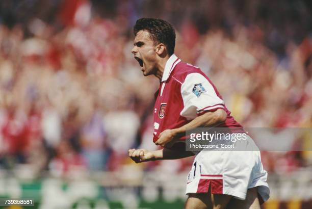 Dutch footballer and midfielder with Arsenal Marc Overmars celebrates after scoring the first goal for Arsenal against Newcastle United in the 1998...