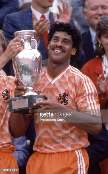 Dutch footballer Frank Rijkaard raises the UEFA European Championship trophy in the air in celebration after Netherlands beat the Soviet Union 20 to...