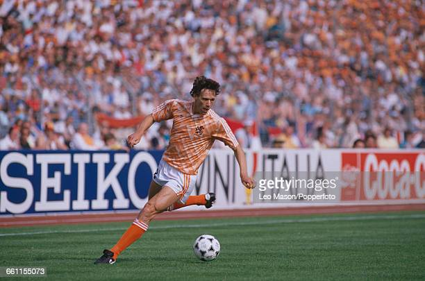 Dutch footballer Marco van Basten runs with the ball during the 1988 UEFA European Football Championship match between England and Holland at the...