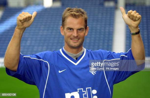 Dutch footballer Ronald de Boer appears in a Rangers shirt for the media at Glasgow's Ibrox Stadium where the final paperwork necessary for his...