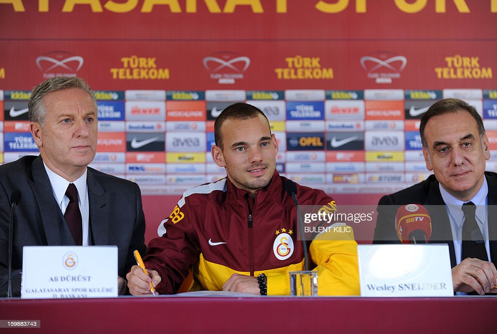 Dutch footballer Wesley Sneijder (C) poses with Galatasaray vice president Ali Durust (L) and Galatasaray CEO Lutfu Aribogan (R) during a signing ceremony in Istanbul on January 22, 2013.Sneijder said Monday he was 'very happy' to put his protracted departure from Inter Milan behind him as he left Serie A for Turkish giants Galatasaray on Monday.