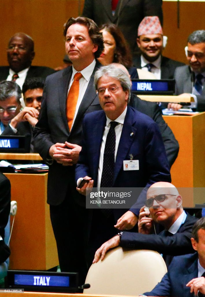 Dutch Foreign Minister Bert Koenders (L) and Italian Foreign Minister Paolo Gentiloni (R) listen for the results at the general assembly room after the fifth round during Election of five non-permanent members of the Security Council at the United Nations in New York on June 28, 2016. / AFP / KENA