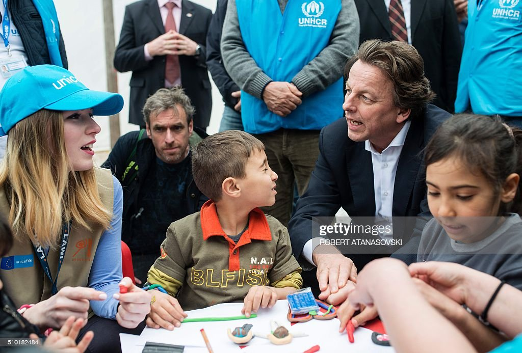 Dutch Foreign Minister Bert Koenders meets young refugees in the transit and registration camp near Gevgelija, on February 14, 2016. Dutch Foreign minister Bert Koenders spent an hour in a Vinojug recipient center near Gevgelija talking with migrants, children, UNICEF and Red Cross representatives, police and others members that are taking care of migrants that are heading to the EU from devastated homes in Syria, Afghanistan and Iraq. / AFP / Robert ATANASOVSKI