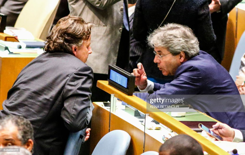 Dutch Foreign Minister Bert Koenders (L) speaks with Italian Foreign Minister Paolo Gentiloni after the fourth round of voting during the election of five non-permanent members of the Security Council at the United Nations in New York on June 28 2016. / AFP / KENA