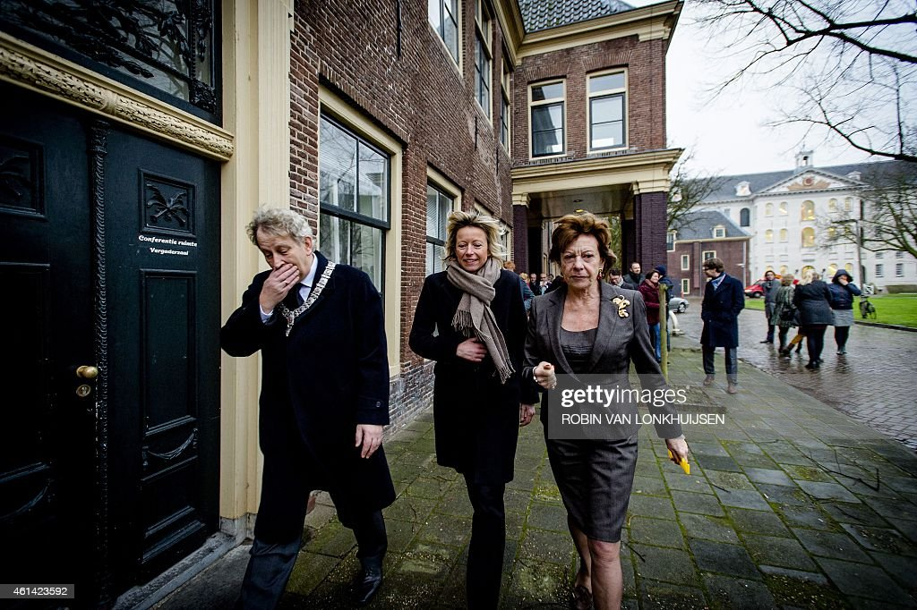 Dutch former European Commissioner for Digital Agenda <a gi-track='captionPersonalityLinkClicked' href=/galleries/search?phrase=Neelie+Kroes&family=editorial&specificpeople=754723 ng-click='$event.stopPropagation()'>Neelie Kroes</a> (r) is welcomed by mayor of Amsterdam Eberhard van der Laan (L) and alderman Kajsa Ollongren (C) on the first day of her new job in Amsterdam on January 12, 2015. Kroes will be 'special envoy' of StartupDelta, a new Dutch initiative for fast growing innovative startups with an international focus. AFP PHOTO/ANP / ROBIN VAN LONKHUIJSEN - netherlands out - belgium out